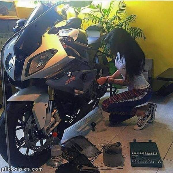 Working On Her Bike